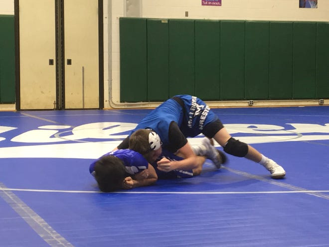 Millburn's Michael Policarpio (top) takes control in a victory at 113 pounds.