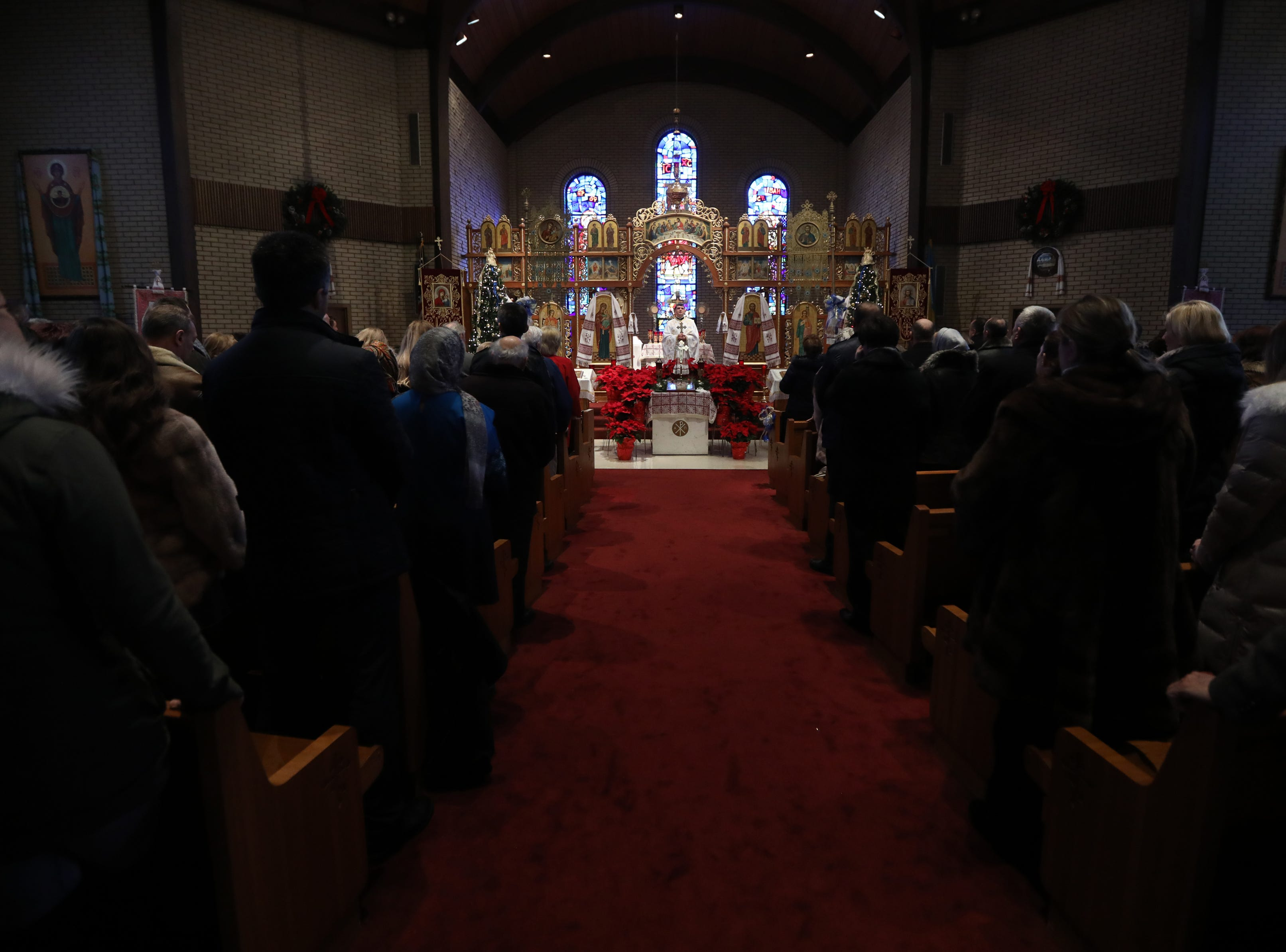 A full Ukrainian Orthodox Holy Ascension Church is shown in Clifton, during Divine Liturgy, Monday, January 7, 2019.
