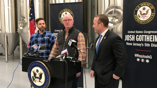Michael Roosevelt (left) and Blake Crawford (middle), co-owners of The Alementary Brewing Co., and Congressman Josh Gottheimer talk with press about how the government shutdown affects small businesses at the company's site in Hackensack on Mon., Jan. 7, 2019.