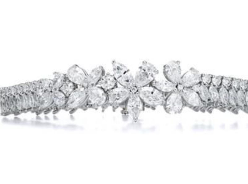 Bracelet in platinum with diamonds ($130,000) — Tiffany & Co. provided Lady Gaga with over 100 carats of diamonds for the 76th annual Golden Globe Awards