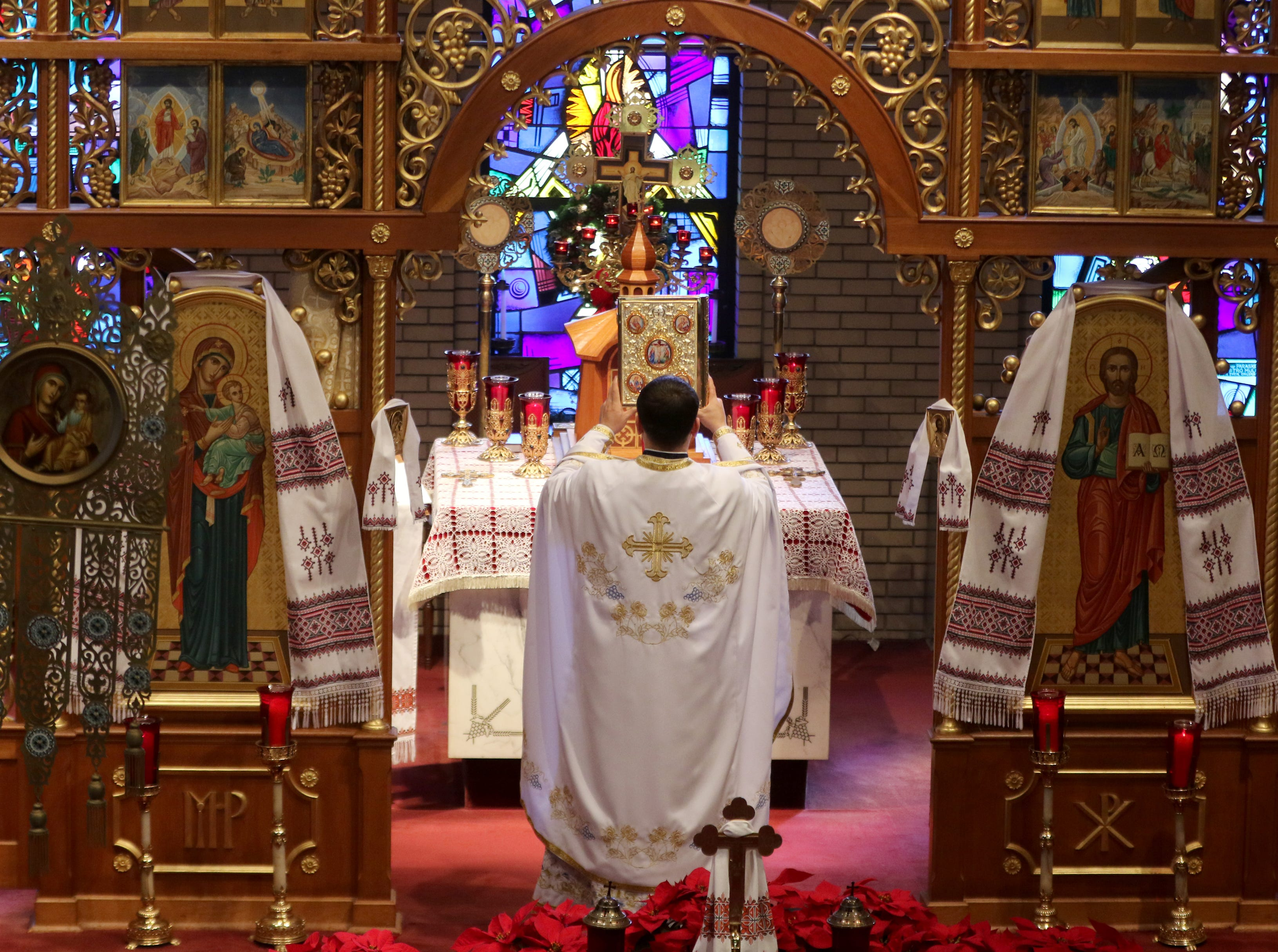 Father Oleksii Holchuk, leads the Divine Liturgy service at the Ukrainian Orthodox Holy Ascension Church, in Clifton.  Ukrainian Orthodox, who follow the Julian calendar, celebrated their first Christmas independently from the Russian church.  Monday, January 7, 2019