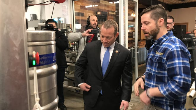 Michael Roosevelt (right), co-owner of the Alementary Brewing Co., gives Congressman Josh Gottheimer a tour of his company's facilities on Mon., Jan. 7, 2019, in Hackensack,