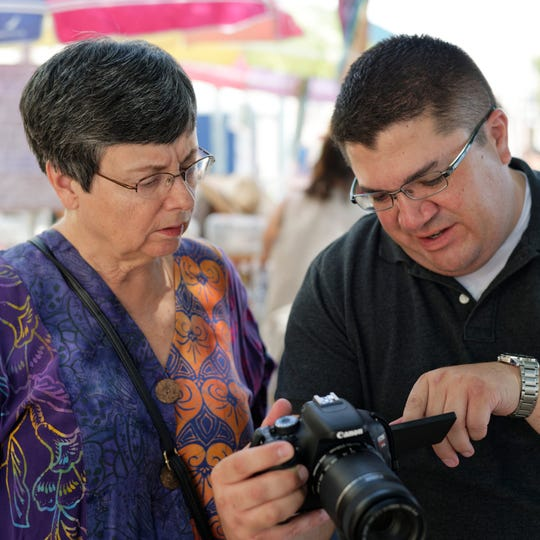Doña Ana Photography Club member Julie Schmitt, left, helps a participant of the 2018 Boot Camp.