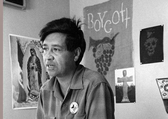 In this 1965 file photo, a César Chávez, a farm worker labor organizer and leader of the California grape strike, speaks from a Delano, Calif., union office.