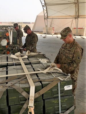 1st Lt. Benjamin Schneider, 295th Ordnance Company, U.S. Army Reserve, inspects a pallet at Al Udeid Air Base, Qatar. Schneider leads a team of 16 Soldiers, under tactical control of the 8th Expeditionary Air Mobility Squadron, in moving sensitive munitions to support operations throughout the theater.