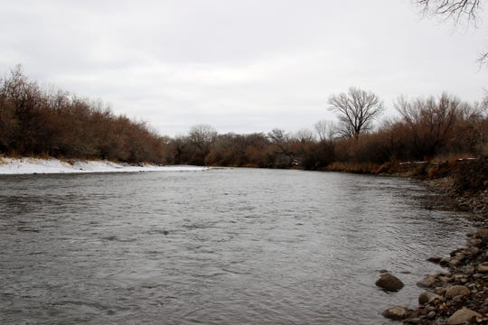 The Animas River flows Monday through Riverside Park in Aztec at much higher levels that were seen earlier this year.