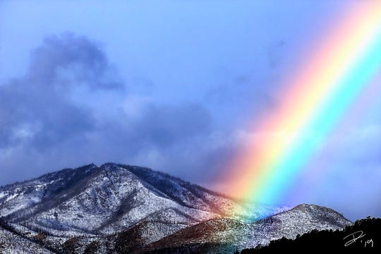 The rainbow seemingly ends near Monjeau Peak, promising treasure of the sort only nature can deliver.