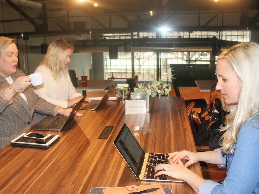 Brooklyn Outdoor Advertising's (from left) Candice Simons, Kiersten Hausmann and Amy Nelson work in Amity's mezzanine section.