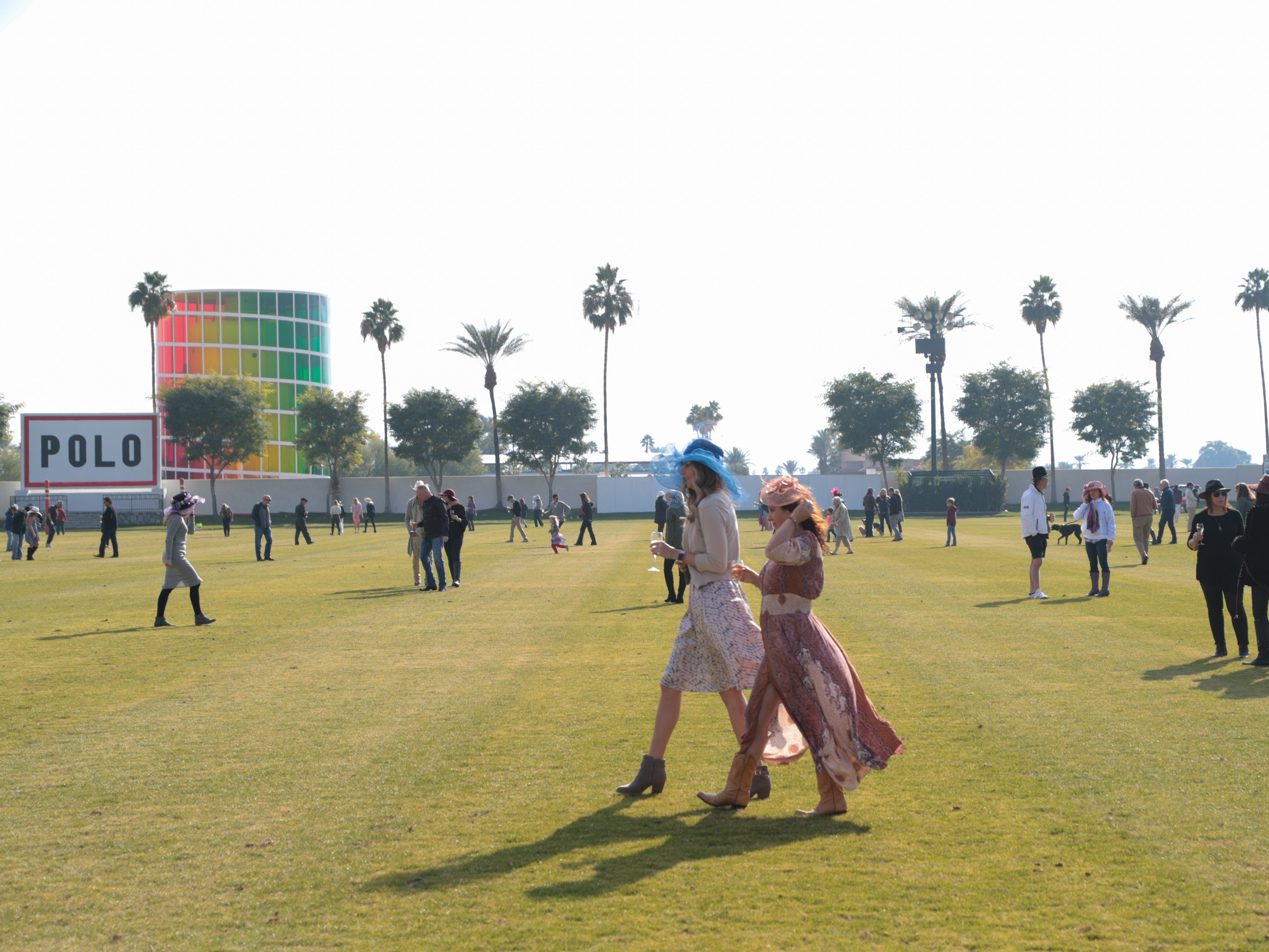 Polo spectators flood the polo field to fill in divets between chukkers at opening day at the Empire Polo Club, Indio, Calif., Sunday, January 6, 2018.