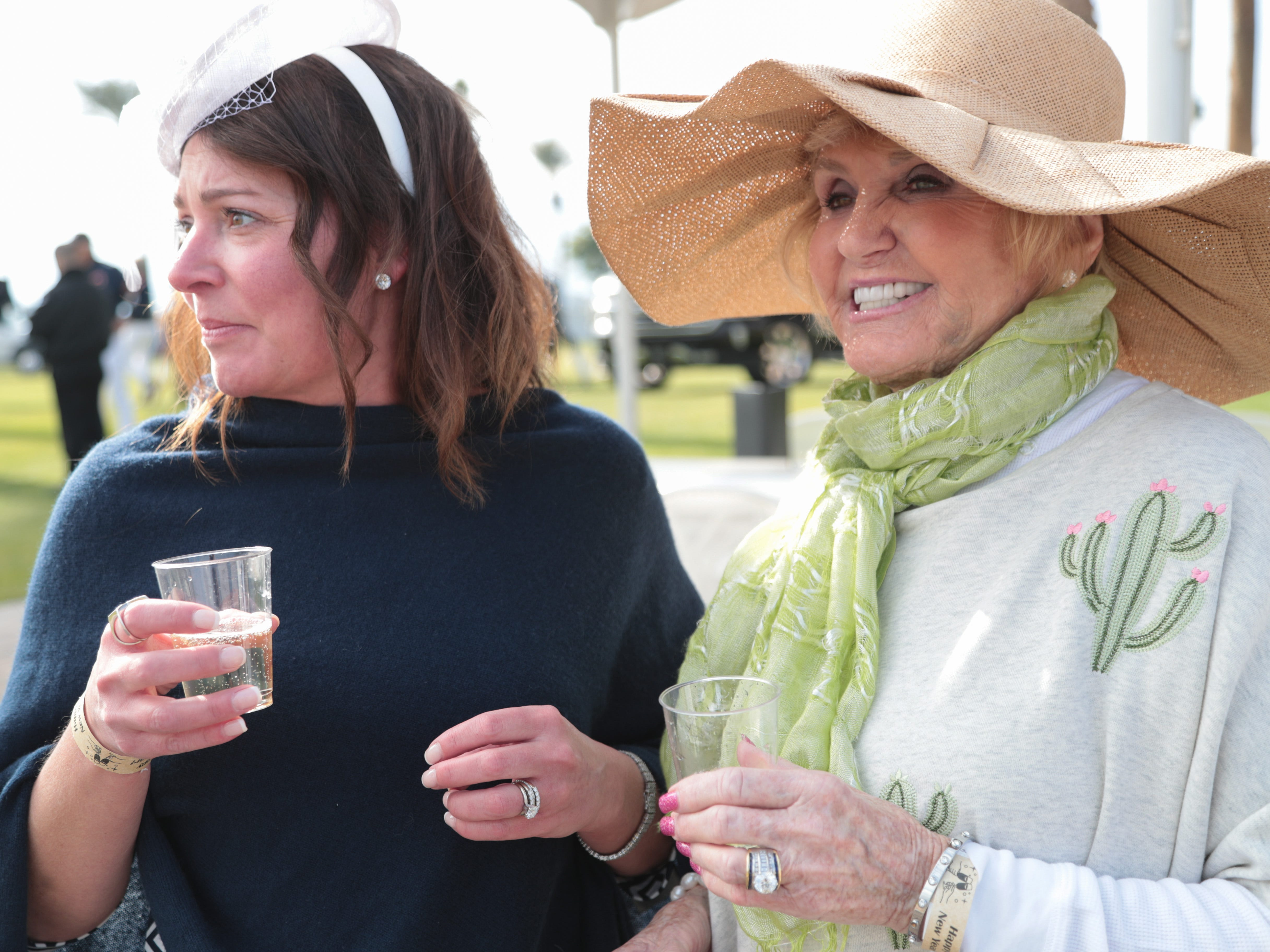 Jessica Morris, left, and Sandra Sladek watch the first match of opening day at the Empire Polo Club, Indio, Calif., Sunday, January 6, 2018.
