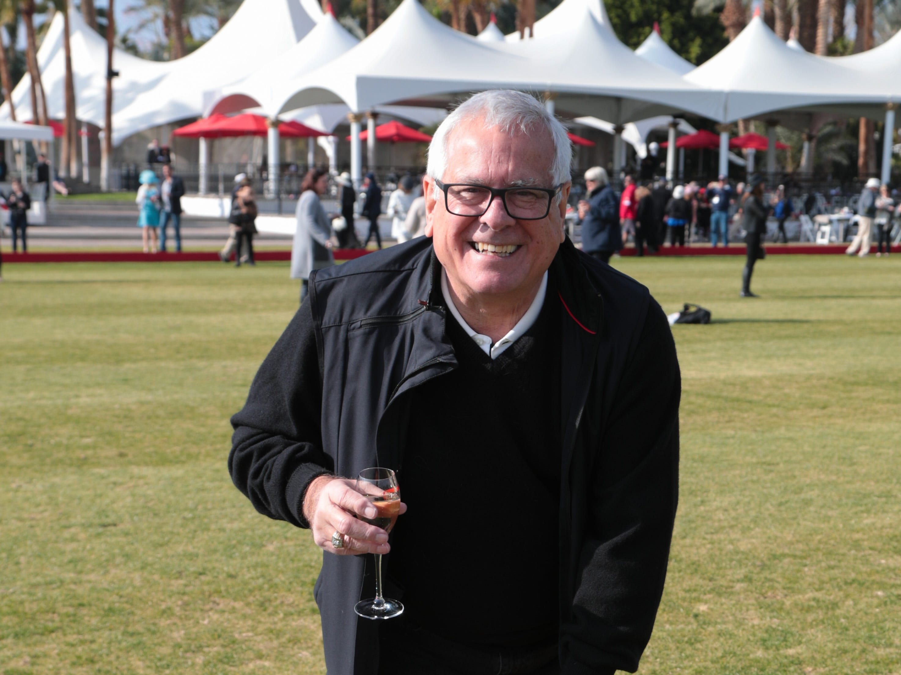 John Crespy fills in divets with his dog Ginger at the Empire Polo Club, Indio, Calif., Sunday, January 6, 2018.