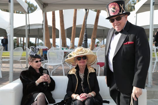 From left, Susan Skogerson, Marjorie Pehta and James Pehta sport hats for the opening day hat competition at the Empire Polo Club, Indio, Calif., Sunday, January 6, 2018.