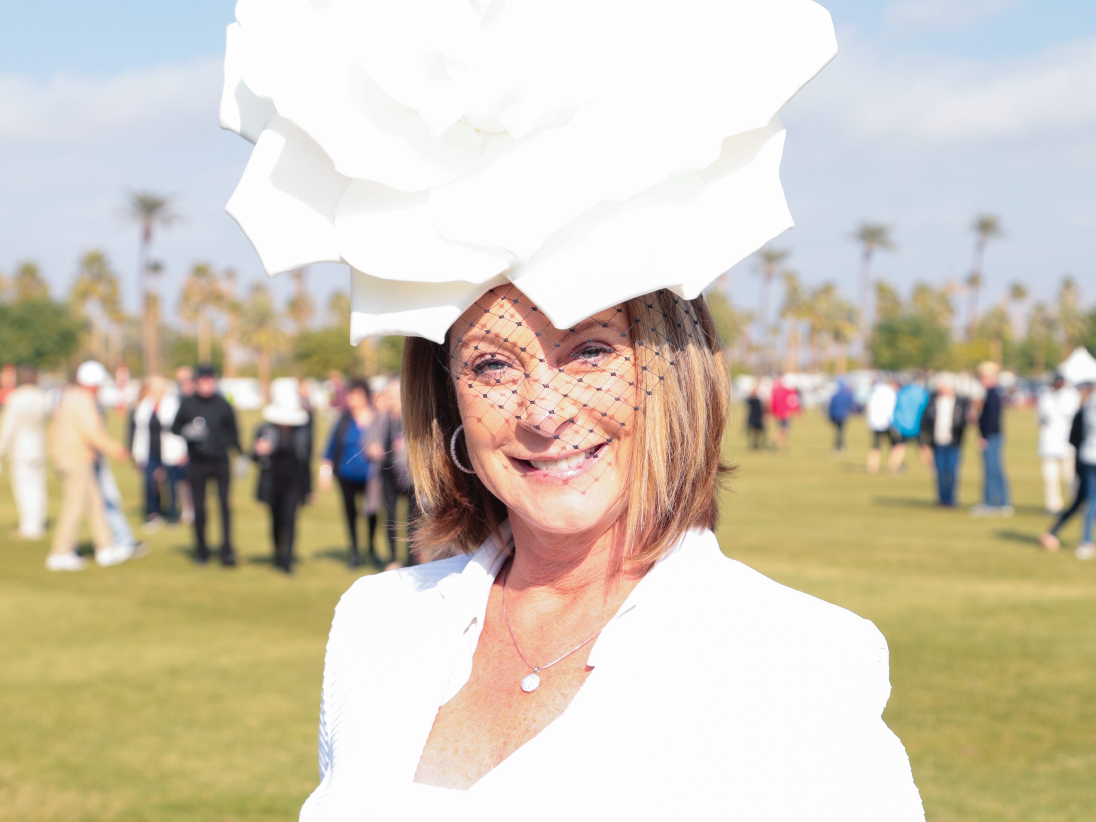 Suzanne Young wears a festive hat for opening day at the Empire Polo Club, Indio, Calif., Sunday, January 6, 2018.