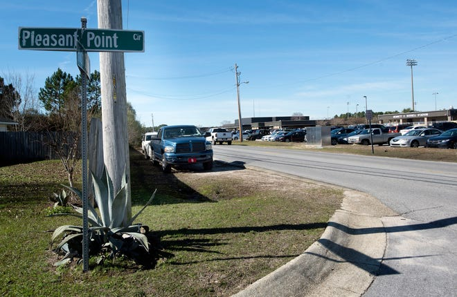 Cars and trucks parked along the right-of-way across from Navarre High School has drawn the ire of some residents next the high school on Monday Jan.7, 2019.