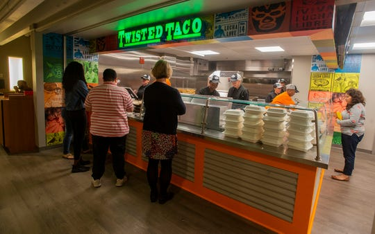 University of West Florida faculty, staff, and students order at the Twisted Taco in the Argo Galley of the University Commons Building in November.