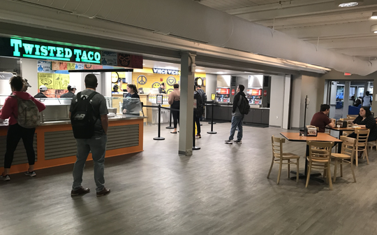 University of West Florida students order at the recently opened Twisted Taco and Which Wich restaurants on the school's campus.