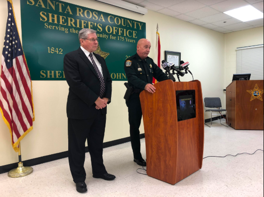 State Attorney Bill Eddins, left, and Santa Rosa County Sheriff Bob Johnson, right, hold a press conference Monday about the arrest of 86-year-old Ramona Maxine Lund. Ramona was arrested and charged with the beating death of her husband, 89-year-old Francis Lund.