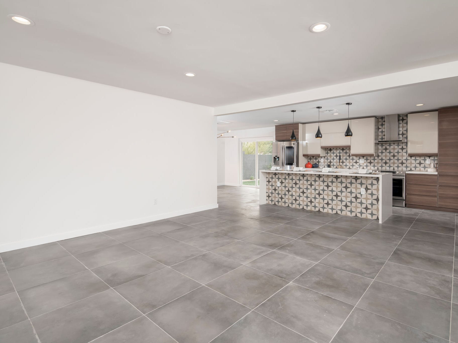 The floor plan was completely opened up during the renovation and the kitchen was pivoted to the back wall.