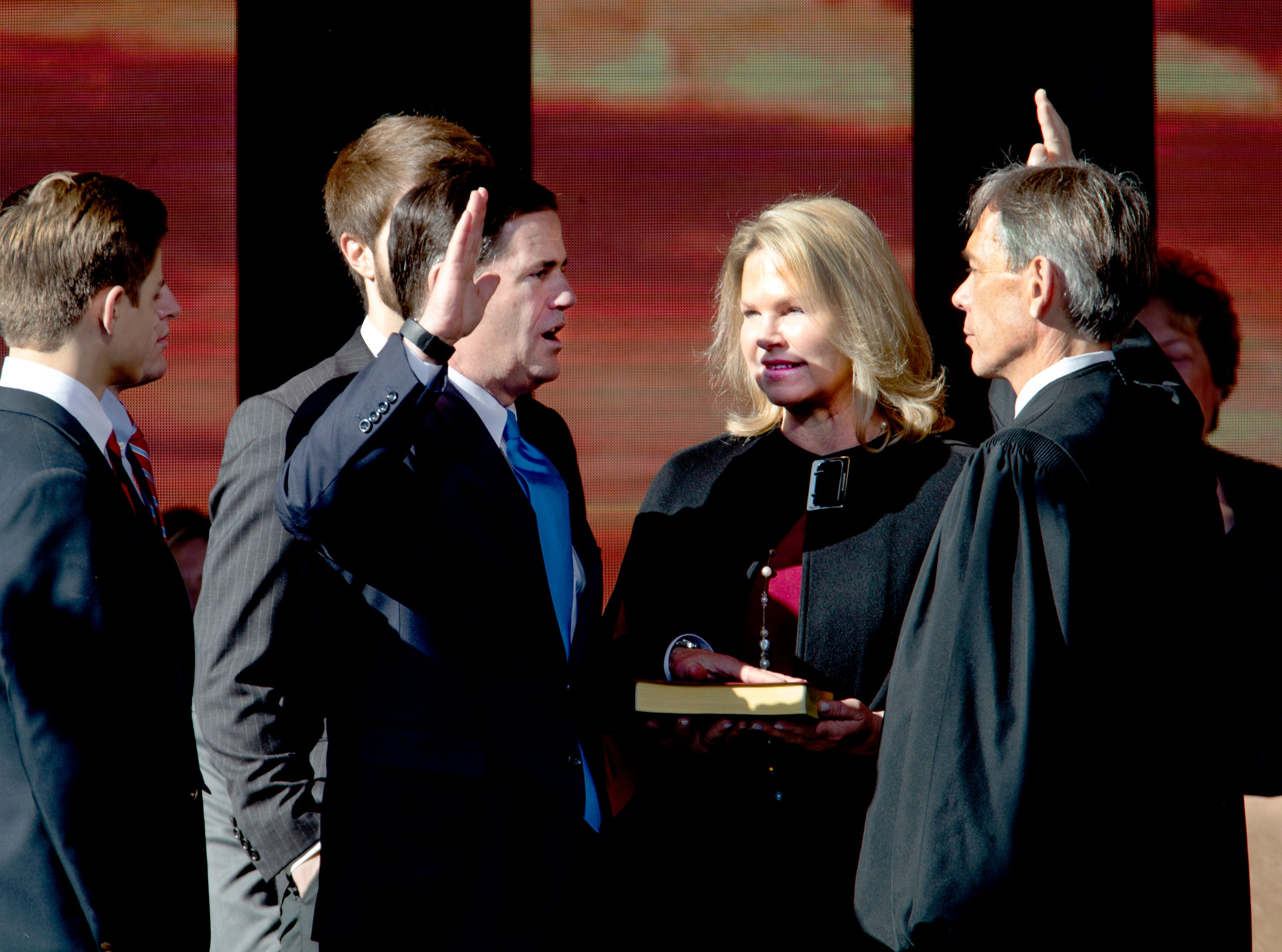 Gov. Doug Ducey is sworn in by Arizona Supreme Court Chief Justice Scott Bales at the Arizona Capitol in Phoenix at the 2019 State of Arizona Inauguration ceremony on Jan. 7, 2019.  Ducey, Secretary of State Katie Hobbs, Attorney General Mark Brnovich, State Treasurer Kimberly Yee, Superintendent of Public Instruction Kathy Hoffman and State Mine Inspector Joe Hart were all sworn in to office during the ceremony.