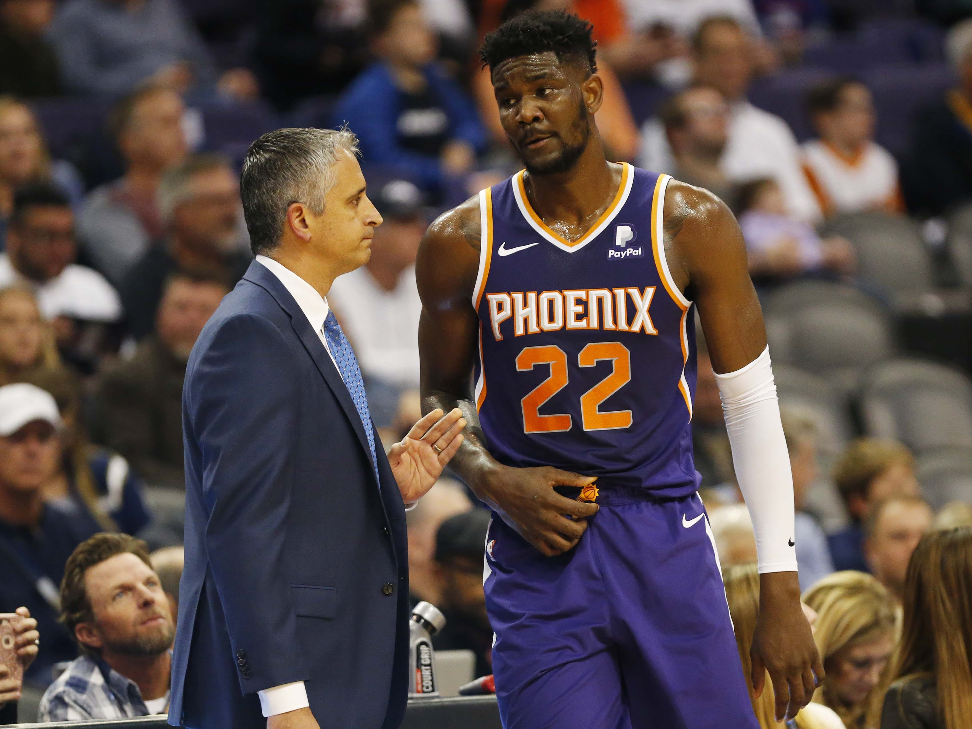 Phoenix Suns head coach Igor Kokoskov talks with Phoenix Suns center Deandre Ayton (22) during the first quarter against the Charlotte Hornets in Phoenix January 6, 2019.