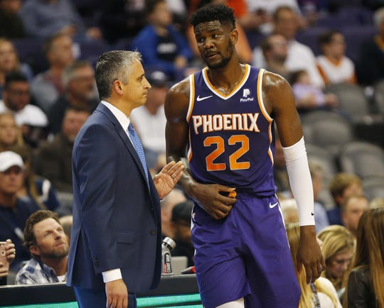 Suns coach Igor Kokoskov talks with rookie center Deandre Ayton during the first quarter of a game Jan. 6 against the Hornets.