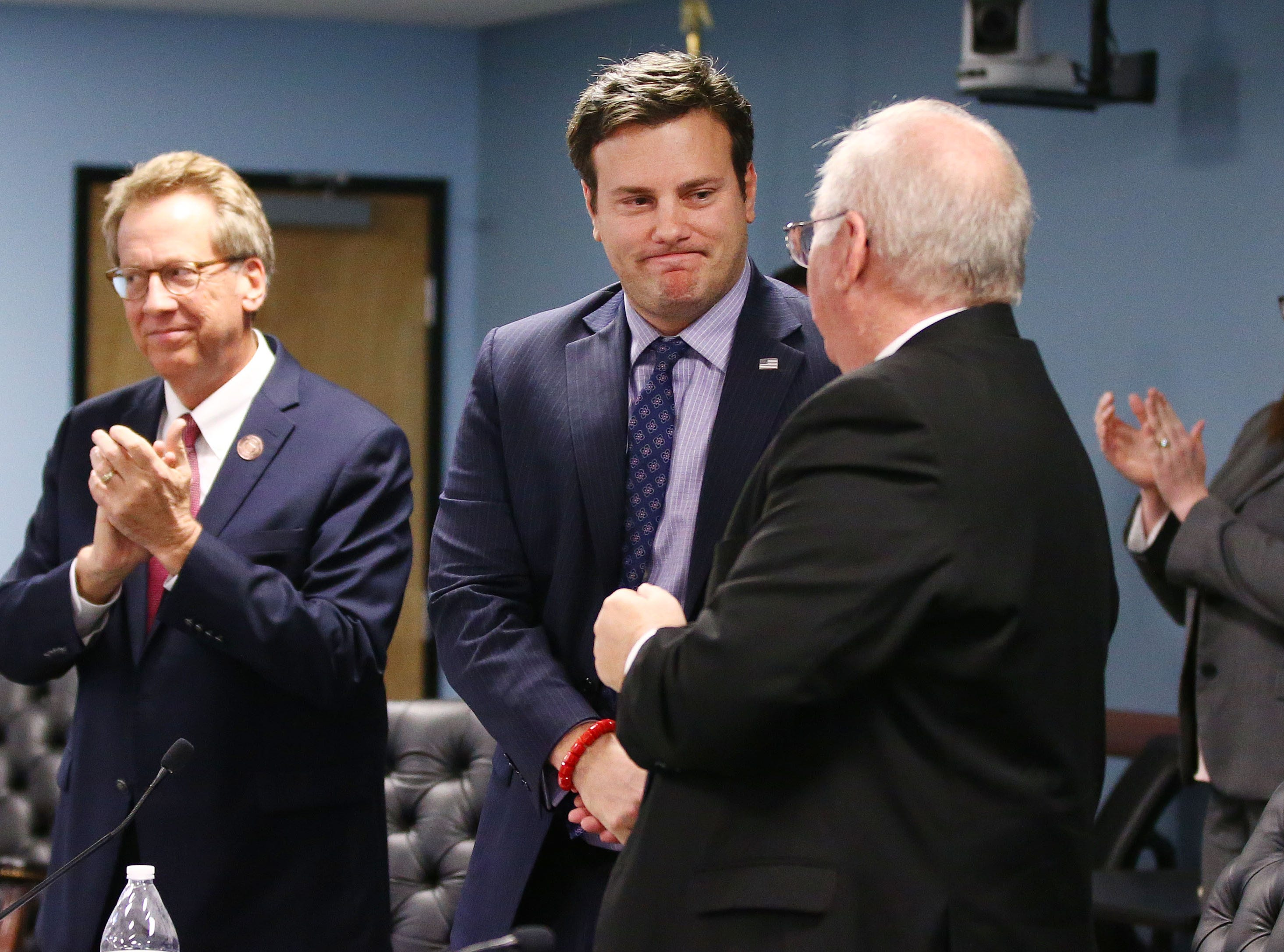 Chairman Tom Forese (center) leaves after the swearing-in ceremony after losing his re-elelction bid last year on Jan. 7 at Arizona Corporation Commission offices in Phoenix.