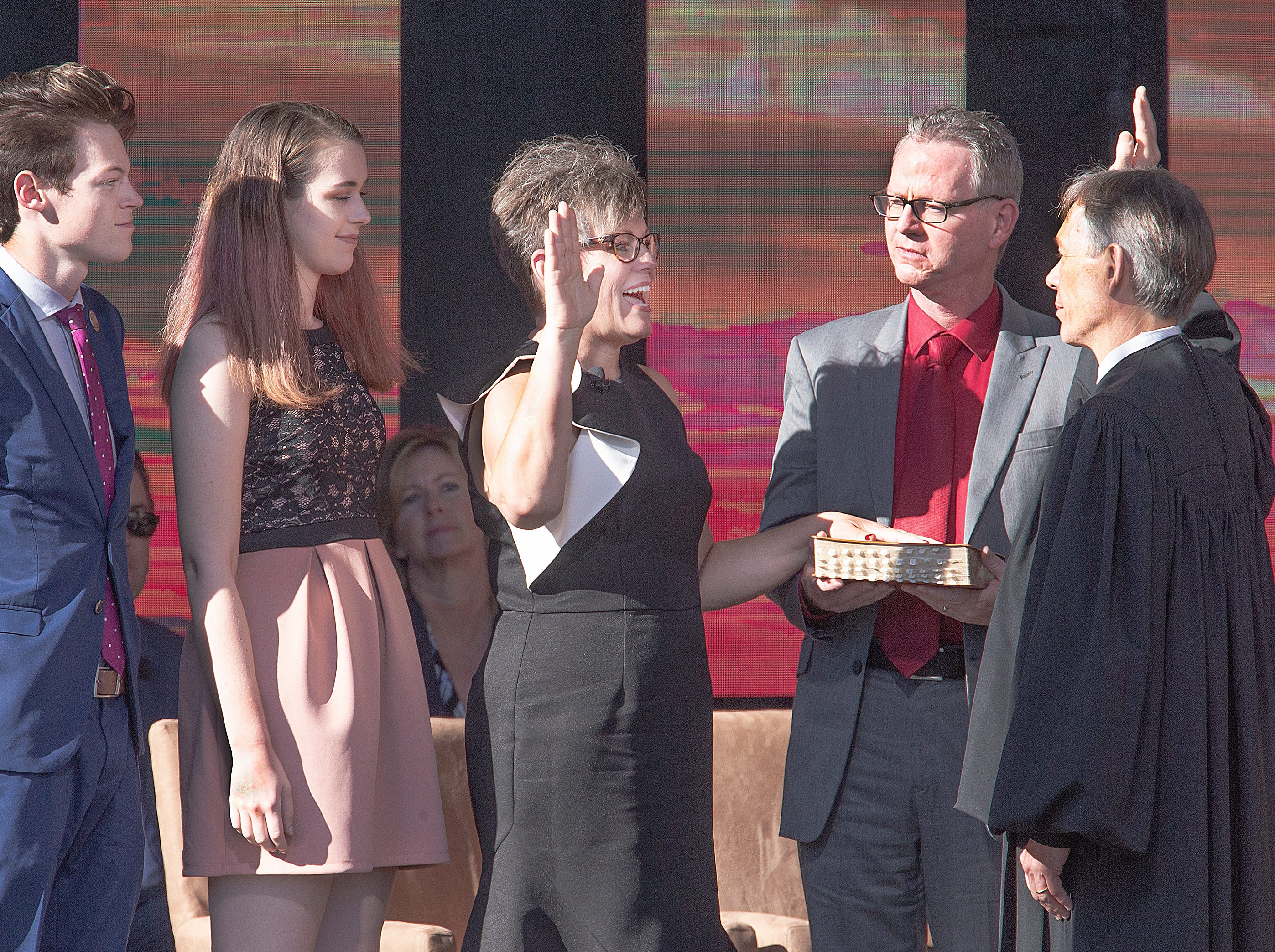Katie Hobbs is sworn in as secretary of state by Arizona Supreme Court Chief Justice Scott Bales at the Arizona Capitol in Phoenix at the 2019 State of Arizona Inauguration ceremony on Jan. 7, 2019.  Gov. Doug Ducey , Hobbs, Attorney General Mark Brnovich, State Treasurer Kimberly Yee, Superintendent of Public Instruction Kathy Hoffman and State Mine Inspector Joe Hart were all sworn i in to office during the ceremony.