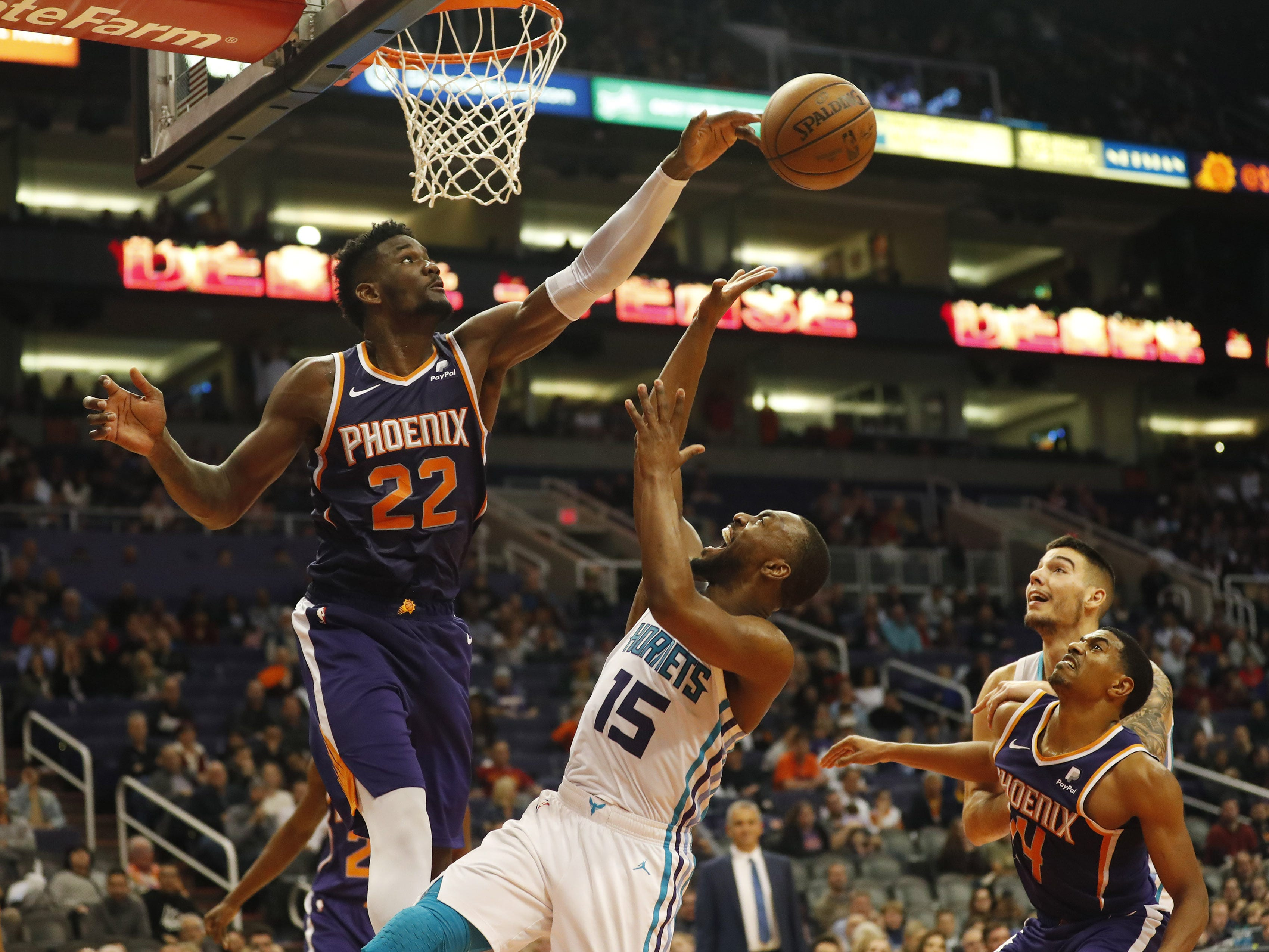 Phoenix Suns center Deandre Ayton (22) blocks a shot by Charlotte Hornets guard Kemba Walker (15) during the fourth quarter in Phoenix January 6, 2019.