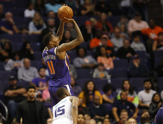 Phoenix Suns guard Jamal Crawford (11) sinks a shot for his 14th point against the Charlotte Hornets during the fourth quarter in Phoenix January 6, 2019. He became only the second player in NBA history to total 11,000 points off the bench.