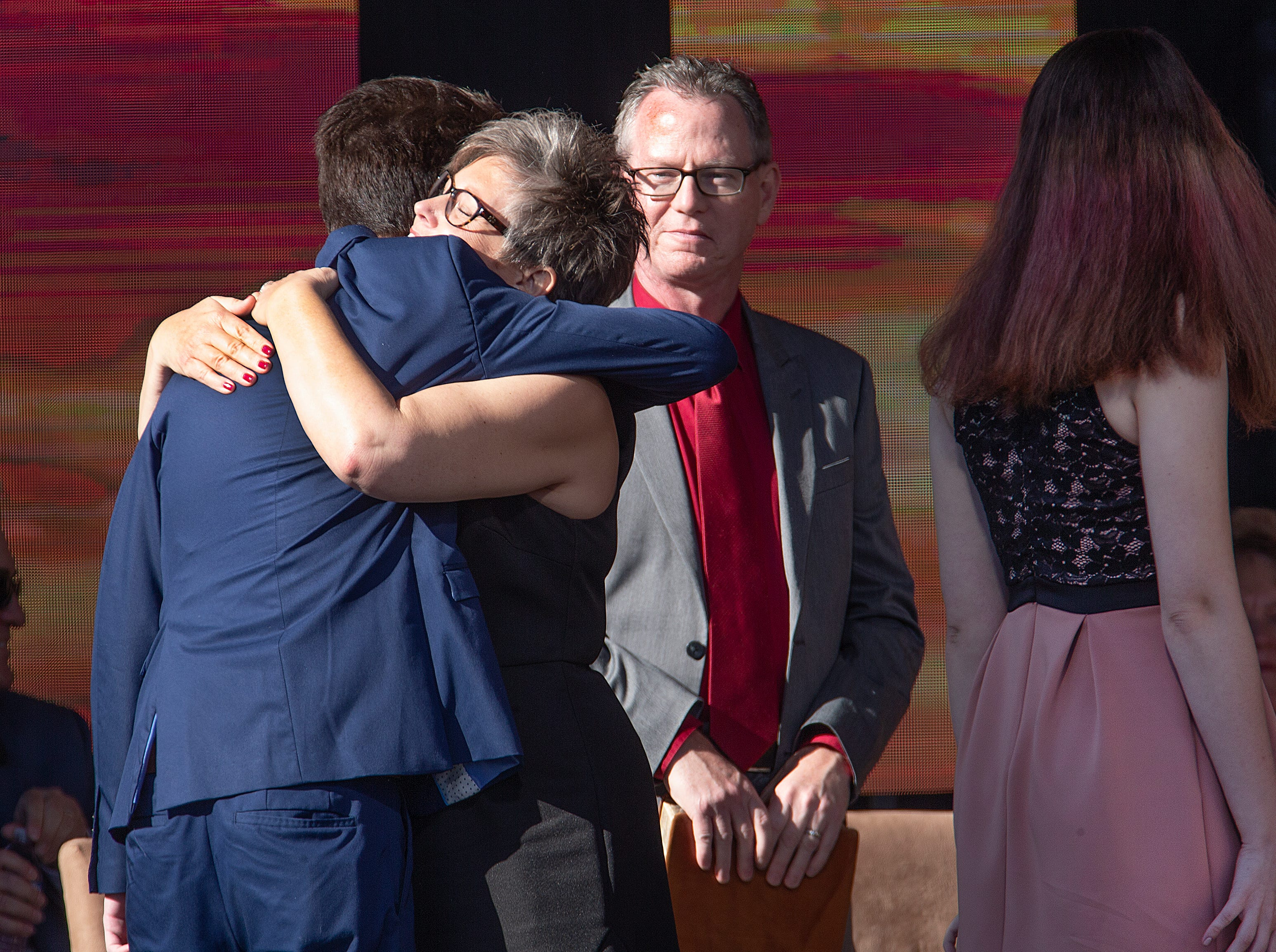 Katie Hobbs hugs family after being sworn in as secretary of state by Arizona Supreme Court Chief Justice Scott Bales at the Arizona Capitol in Phoenix at the 2019 State of Arizona Inauguration ceremony on Jan. 7, 2019.  Gov. Doug Ducey , Hobbs, Attorney General Mark Brnovich, State Treasurer Kimberly Yee, Superintendent of Public Instruction Kathy Hoffman and State Mine Inspector Joe Hart were all sworn in to office during the ceremony.
