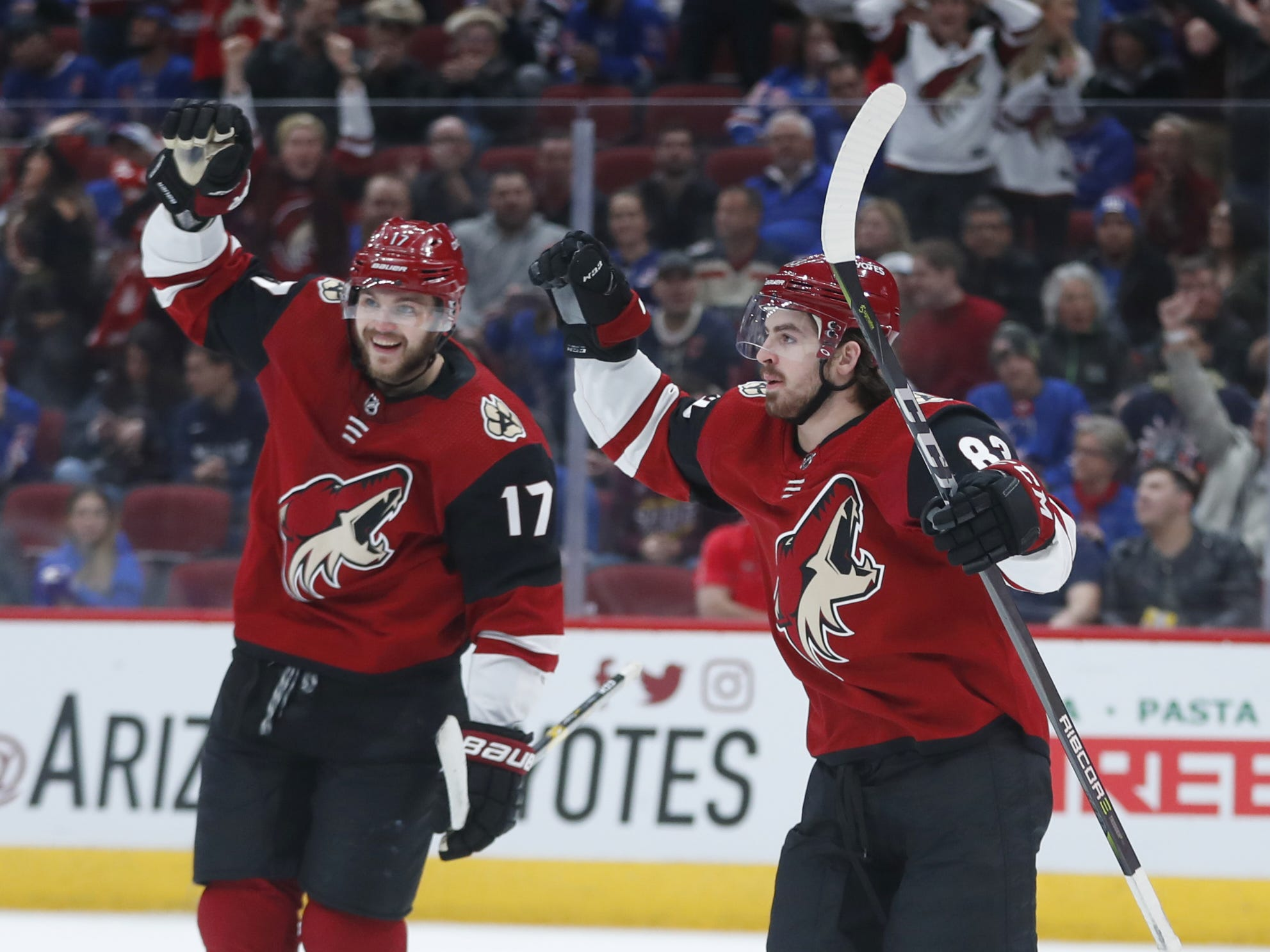 Coyotes' Alex Galchenyuk (17) and Conor Garland (83) celebrate a goal from Nick Cousins against the Rangers during the second period at Gila River Arena in Glendale, Ariz. on January 6, 2019.