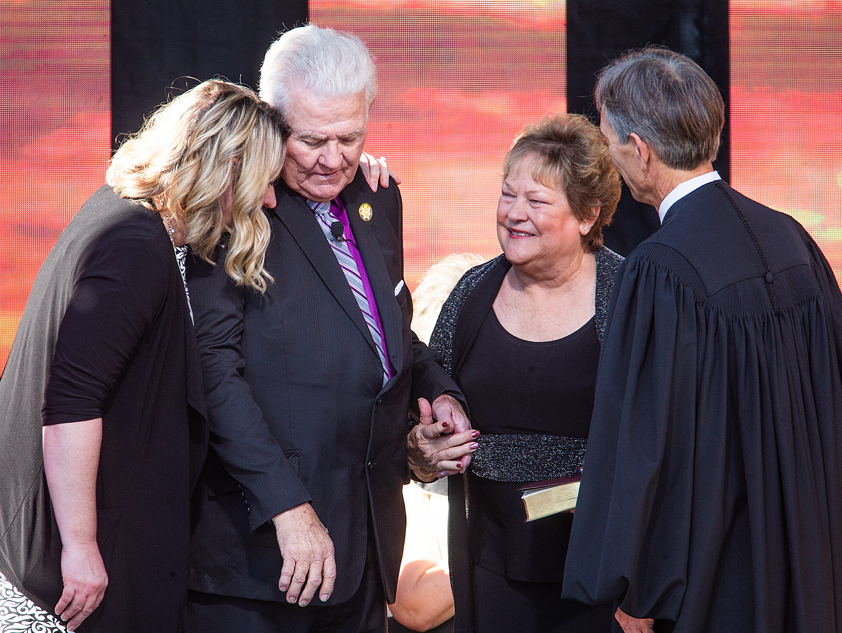 Arizona State Mine Inspector Joe Hart is surrounded by family after being sworn in by Arizona Supreme Court Chief Justice Scott Bales at the Arizona Capitol in Phoenix at the 2019 State of Arizona Inauguration ceremony on Jan. 7, 2019.  Gov. Doug Ducey , Secretary of State Katie Hobbs, Attorney General Mark Brnovich, State Treasurer Kimberly Yee, Superintendent of Public Instruction Kathy Hoffman and Hart were all sworn in to office during the ceremony.