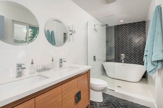 Creative layout changes made for a larger bathroom.