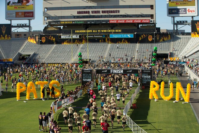 Runners finish the 4.2 mile race in Sun Devil Stadium during the 13th annual Pat's Run in Tempe on Saturday, April 22, 2017.