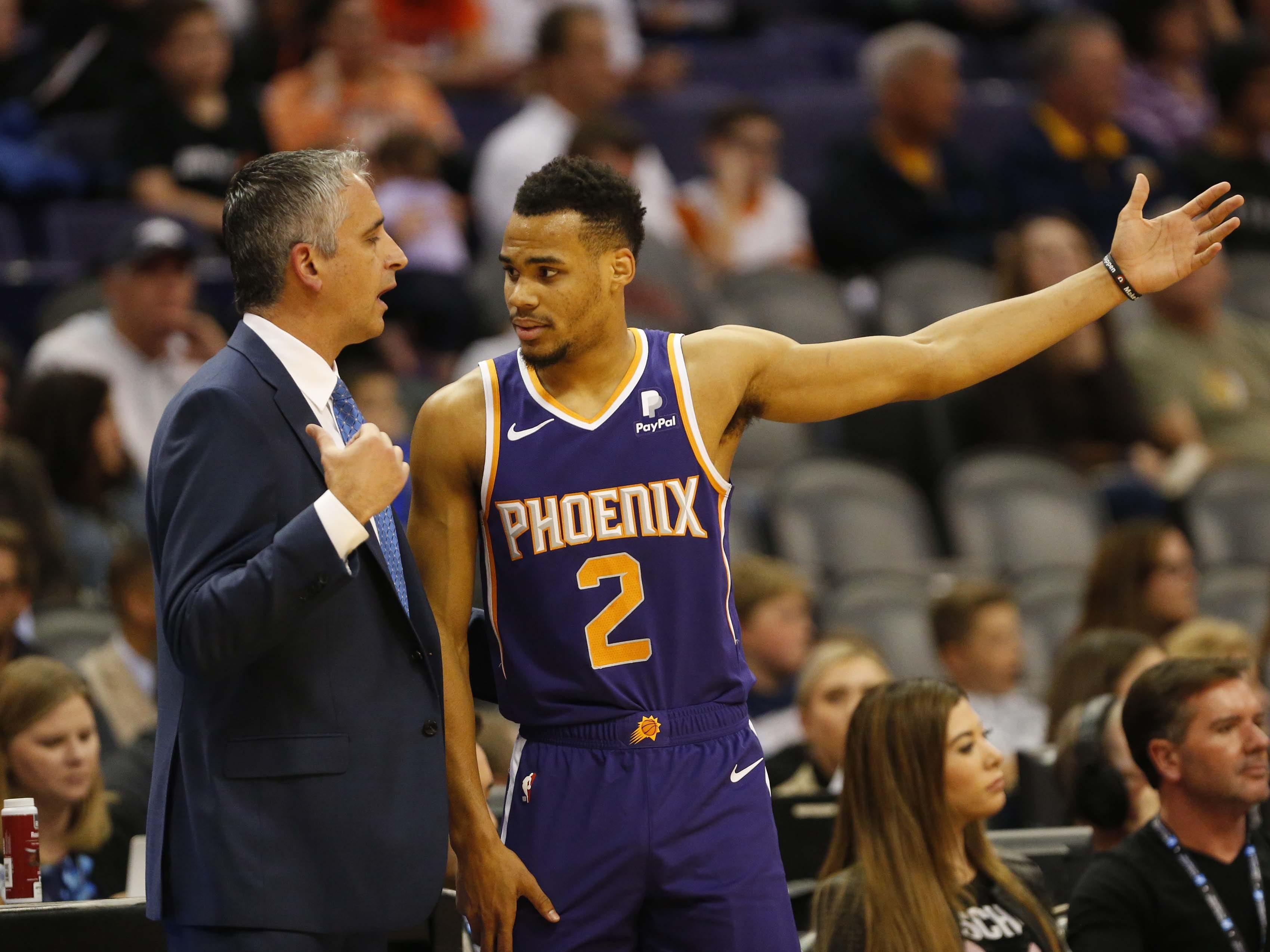 Phoenix Suns head coach Igor Kokoskov talks with Phoenix Suns guard Elie Okobo (2) during the second quarter against the Charlotte Hornets in Phoenix January 6, 2019.