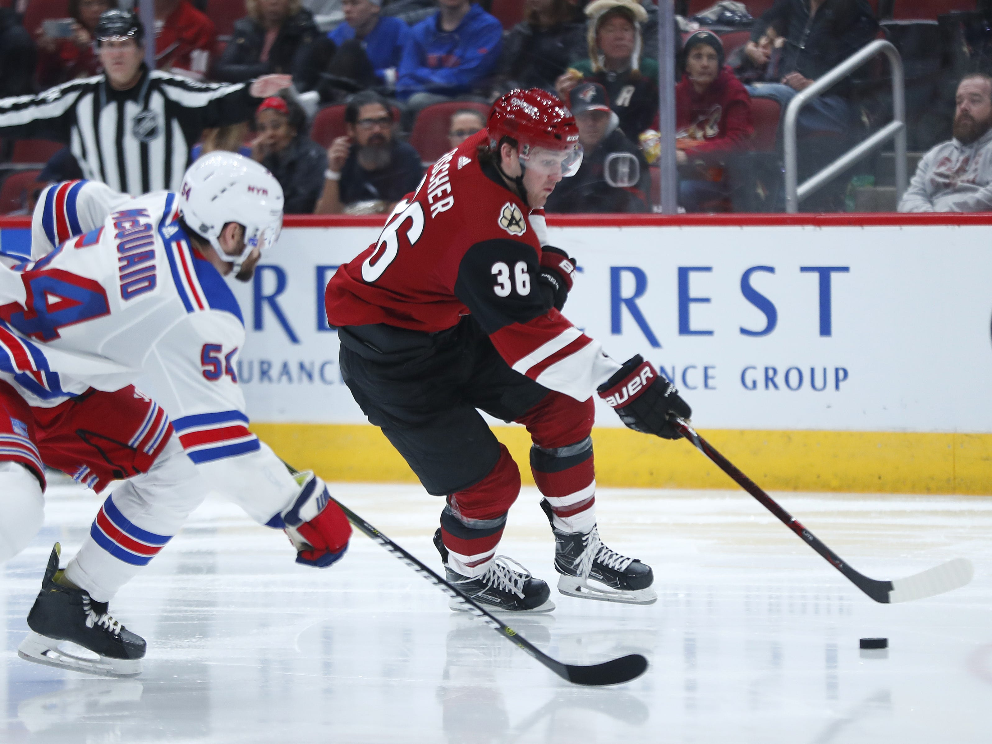 Coyotes' Christian Fischer (36) gathers the puck for a shot against Rangers' Adam McQuaid (54) during the second period at Gila River Arena in Glendale, Ariz. on January 6, 2019.