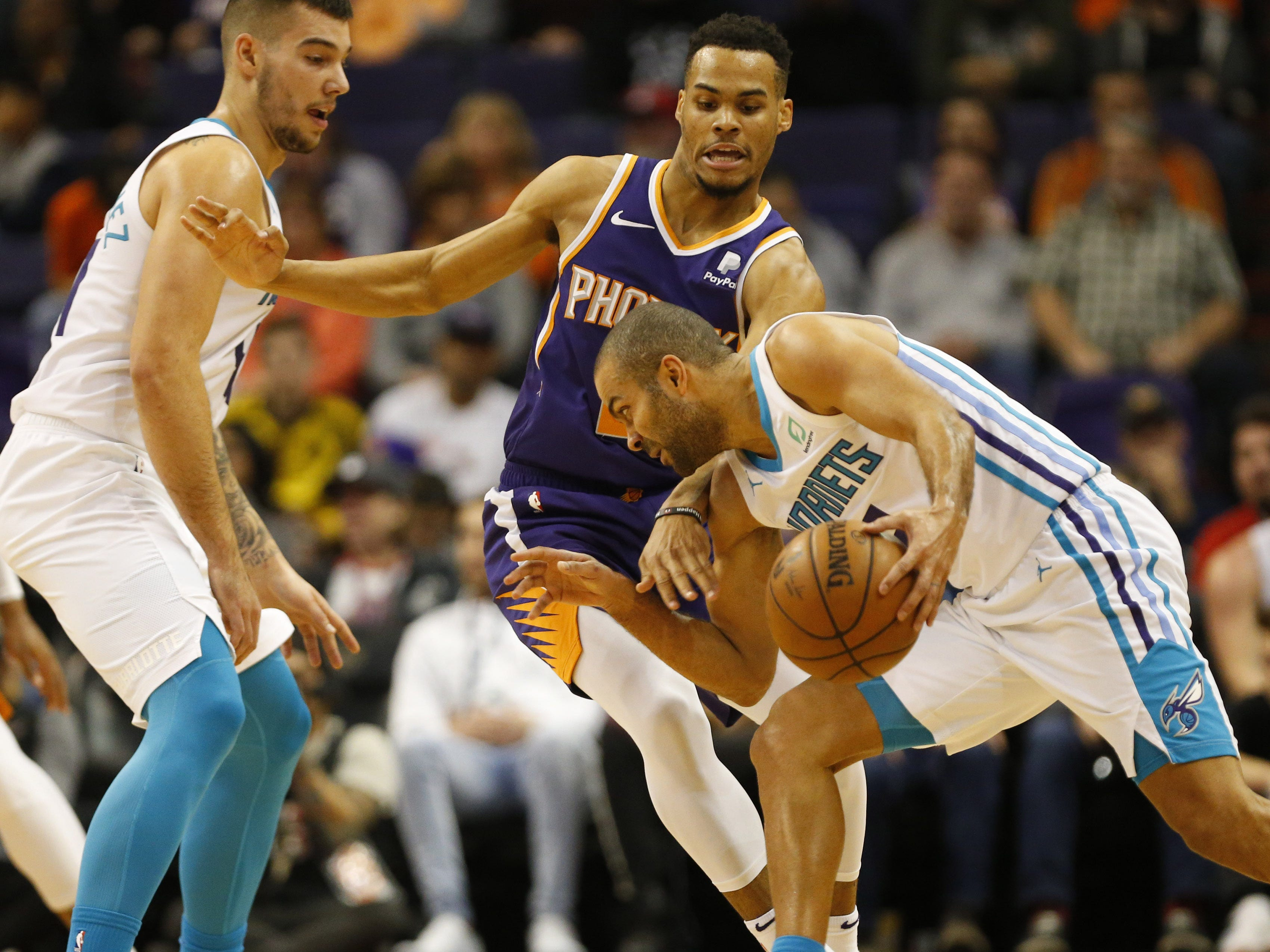 Phoenix Suns guard Elie Okobo (2) guards Charlotte Hornets guard Tony Parker (9) during the second quarter in Phoenix January 6, 2019.