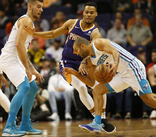 Phoenix Suns guard Elie Okobo (2) guards Charlotte Hornets guard Tony Parker (9) during the second quarter in Phoenix January 6, 2019.