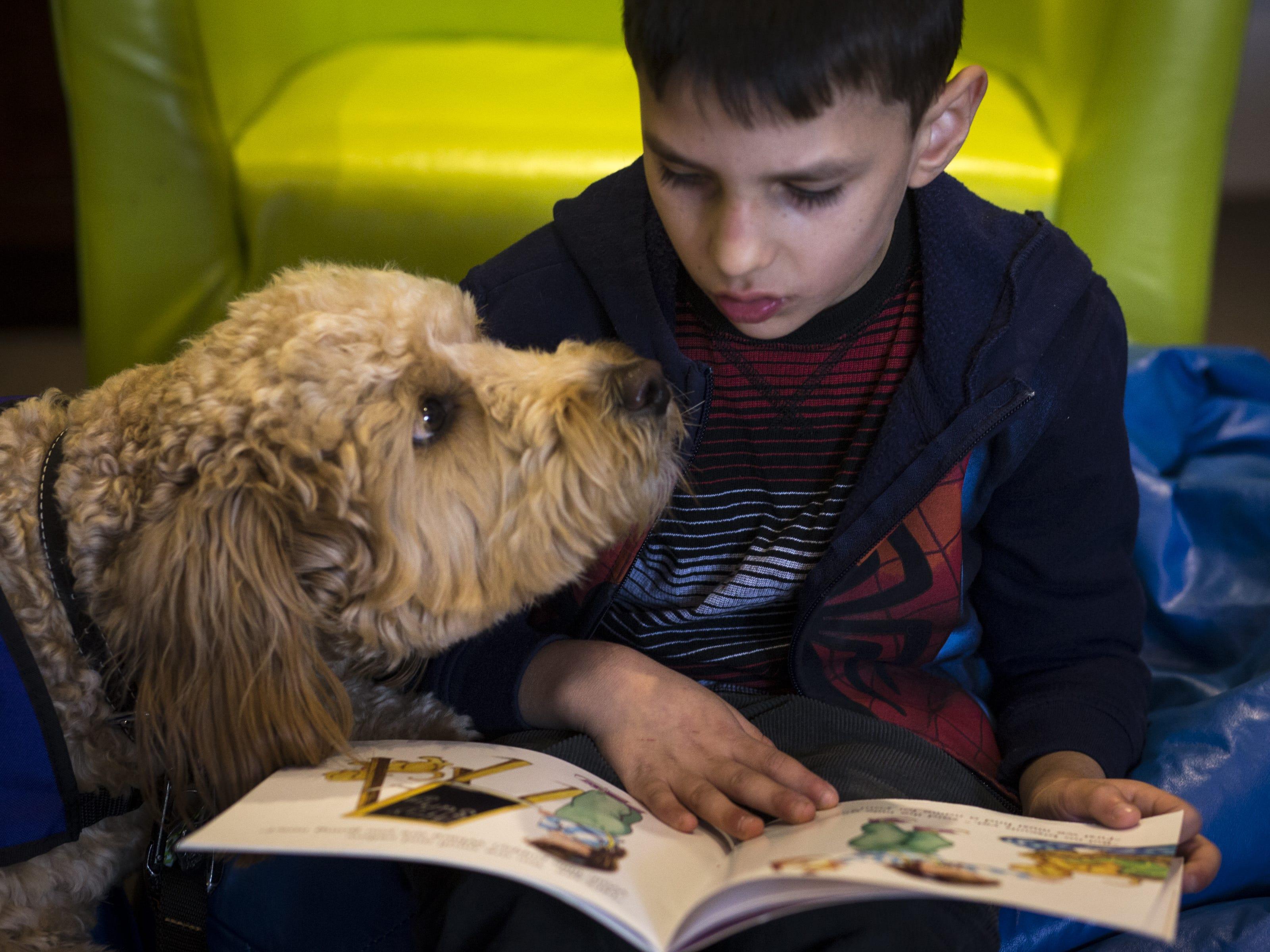 Zane reads to Caymus, Jan. 7, 2019, at Aurora Day School in Peoria.