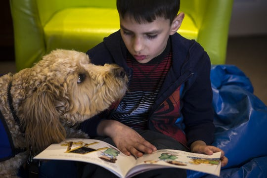 Zane reads to Caymus, Jan. 7, 2019, at Aurora Day School in Peoria.