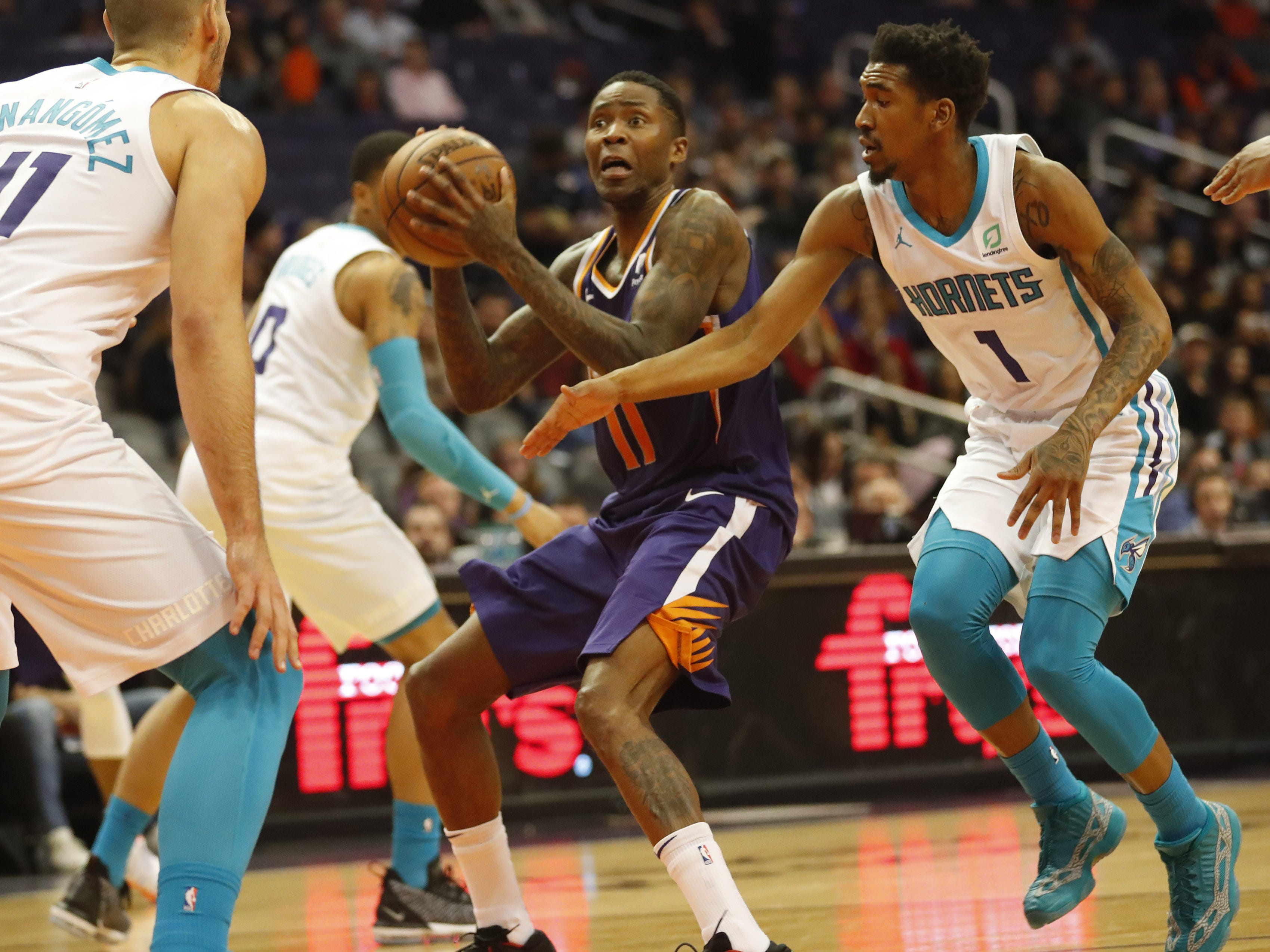 Phoenix Suns guard Jamal Crawford (11) shields the ball from Charlotte Hornets guard Malik Monk (1) during the second quarter in Phoenix January 6, 2019.