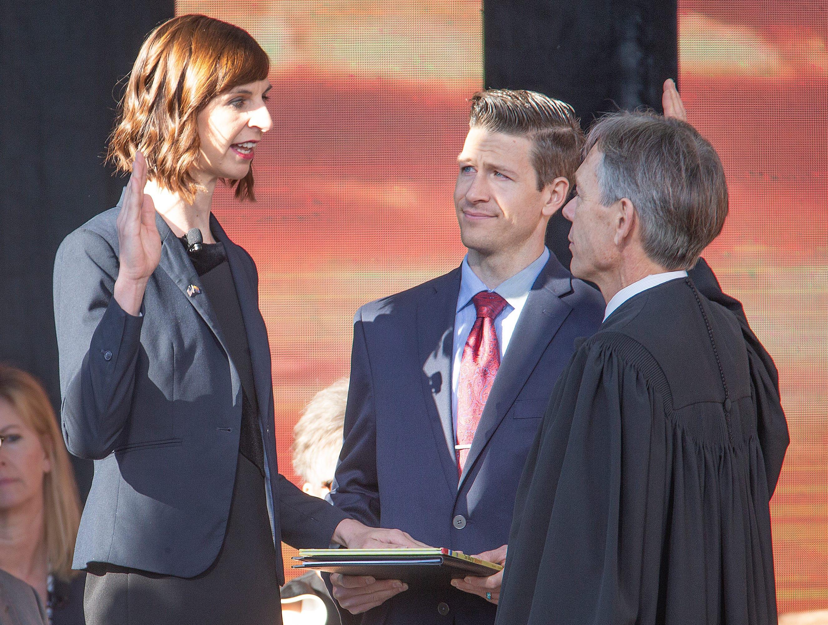 Kathy Hoffman is sworn in as Arizona Superintendent of Public Instruction by Arizona Supreme Court Chief Justice Scott Bales at the Arizona Capitol in Phoenix at the 2019 State of Arizona Inauguration ceremony.  Gov. Doug Ducey , Secretary of State Katie Hobbs, Attorney General Mark Brnovich, State Treasurer Kimberly Yee, Hoffman and State Mine Inspector Joe Hart were all sworn in to office during the ceremony.