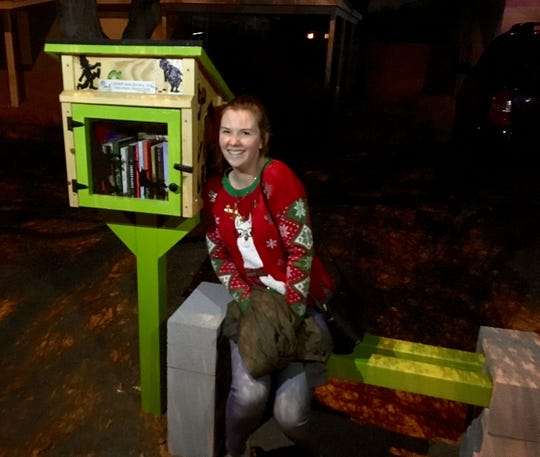 Taylor Penn brought over two boxes and a garbage bag full of books to donate to the Little Free Library.