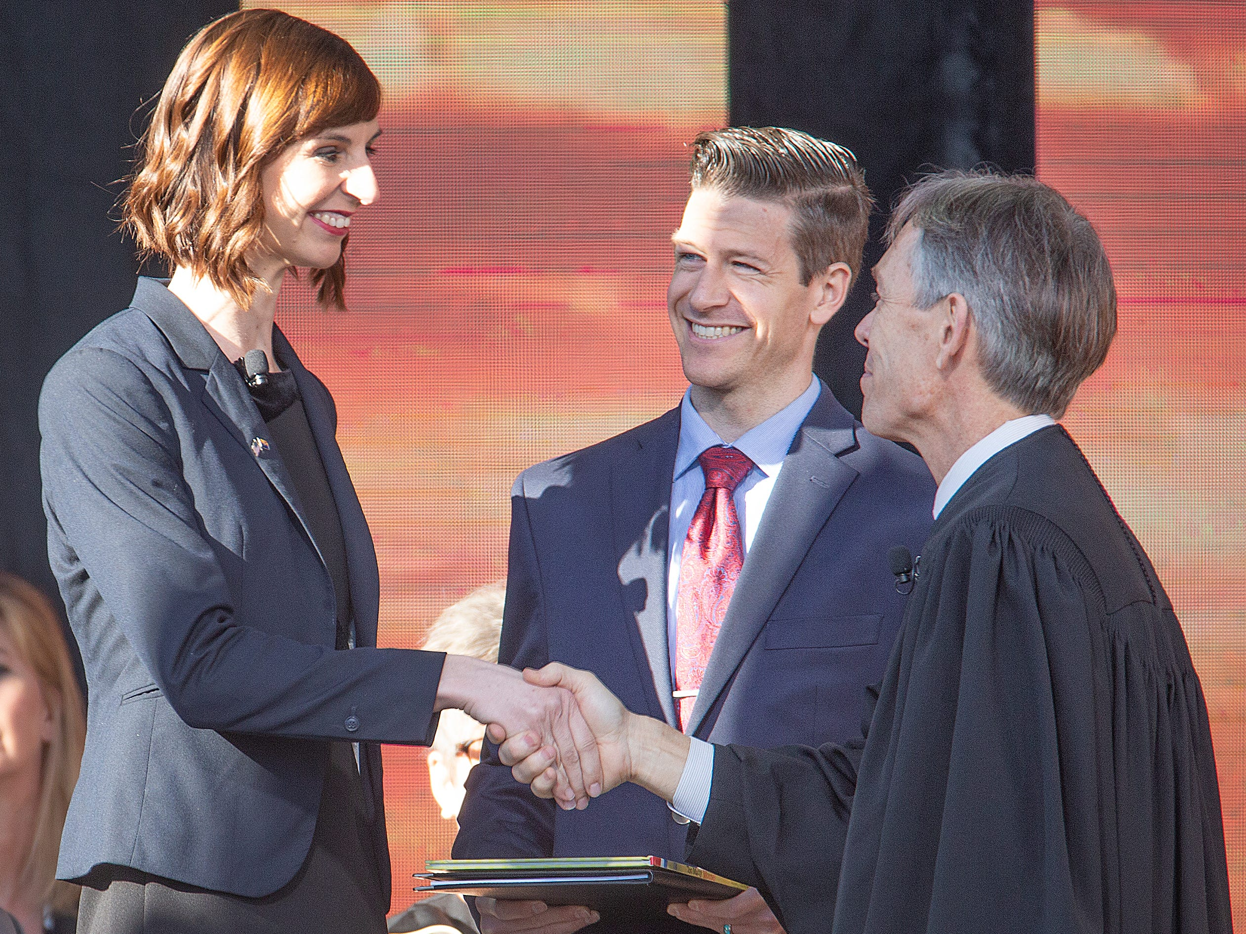 Kathy Hoffman is congratulated after being sworn in as Arizona superintendent of public instruction by Arizona Supreme Court Chief Justice Scott Bales at the Arizona Capitol in Phoenix at the 2019 State of Arizona Inauguration ceremony on Jan. 7, 2019.  Gov. Doug Ducey , Secretary of State Katie Hobbs, Attorney General Mark Brnovich, State Treasurer Kimberly Yee, Hoffman and State Mine Inspector Joe Hart were all sworn in to office during the ceremony.