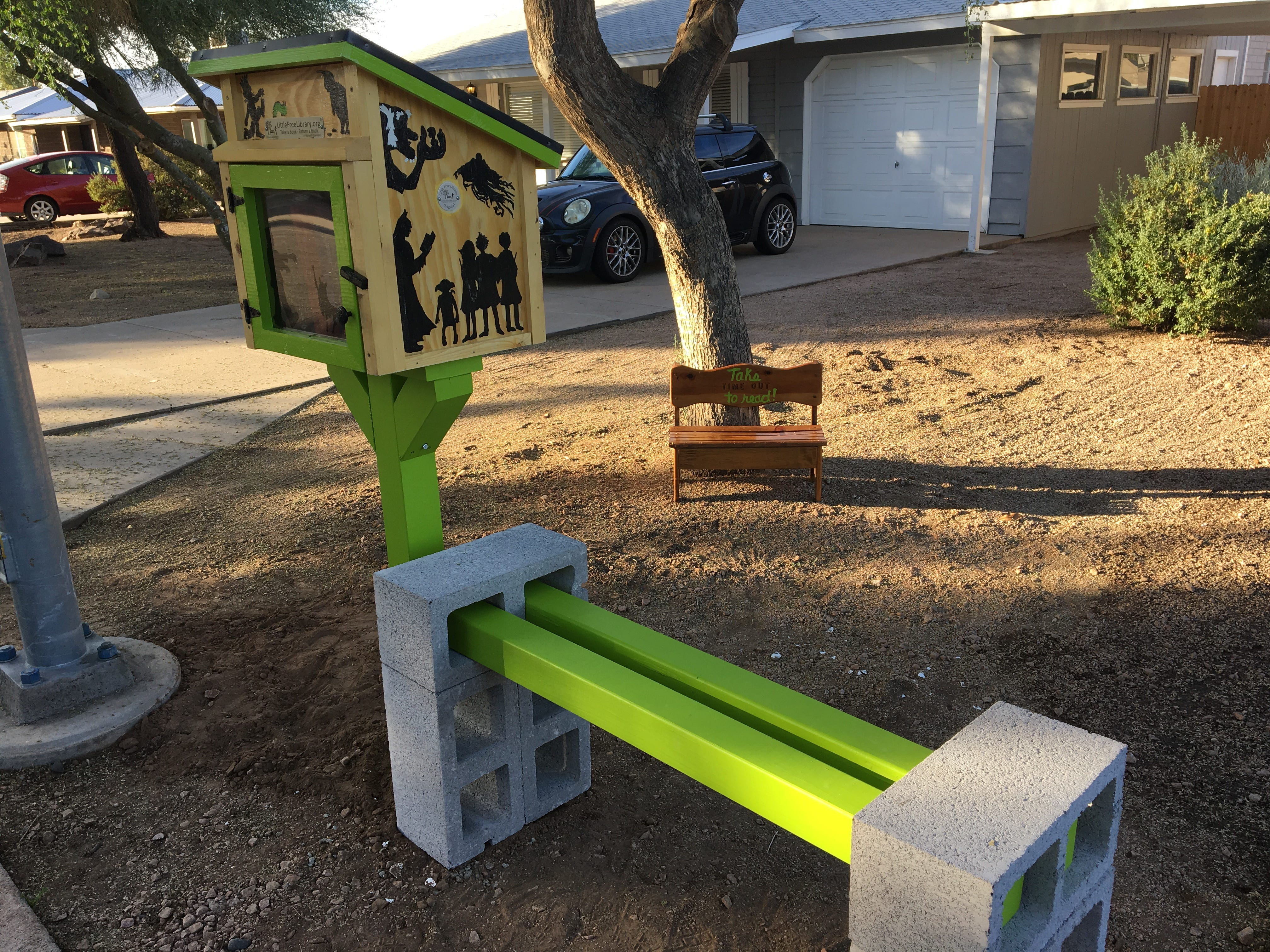"""Karina Bland met Shaun in a parking lot to buy a bench for $10. It had the words """"TIME OUT"""" carved on it. She painted it to say, """"Take TIME OUT to Read."""""""