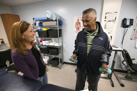 Sharon Pellman, a physical therapist, works with Vincent Hall on exercises for his rehabilitation at the Circle the City Medical Respite Center in Phoenix on Jan. 4, 2019. Hall, who was homeless, came to the Circle the City Medical Respite Center after being involved in a car accident where he had a fractured skull several months earlier.