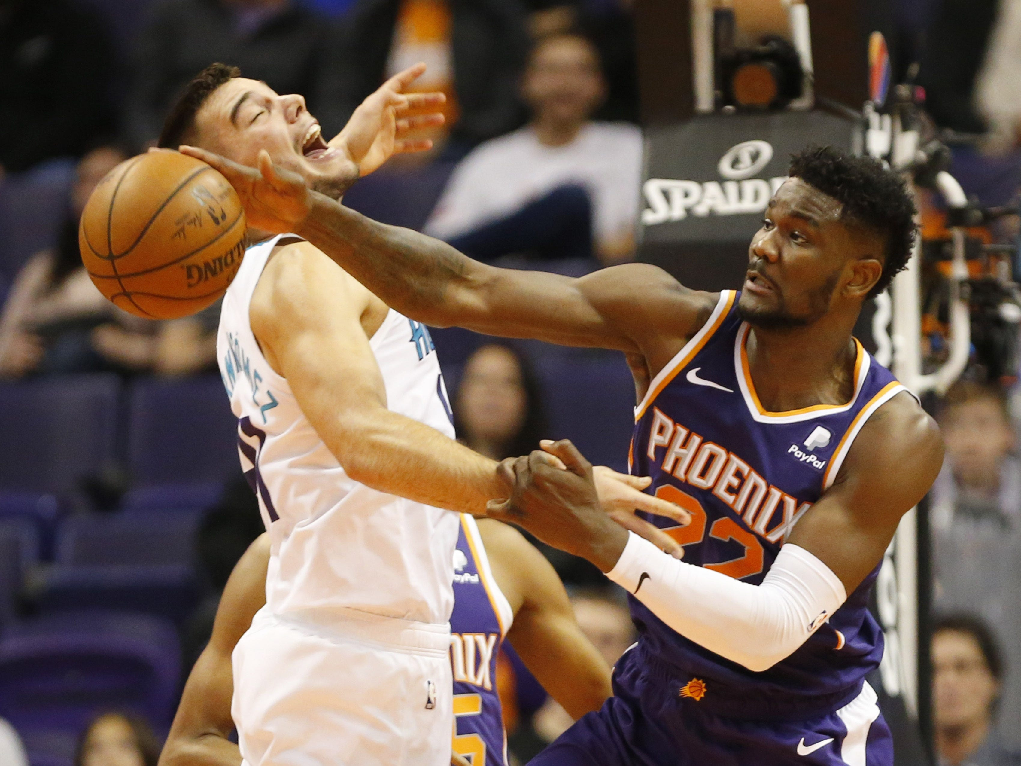 Phoenix Suns center Deandre Ayton (22) grabs a rebounds from Charlotte Hornets center Willy Hernangomez (41) during the second quarter in Phoenix January 6, 2019.