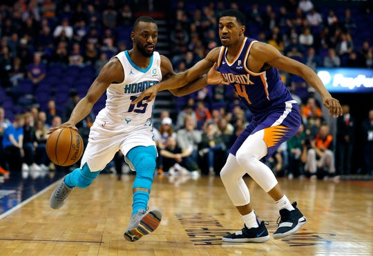 Charlotte Hornets guard Kemba Walker (15) in the first half during an NBA basketball game against the Phoenix Suns, Sunday, Jan. 6, 2019, in Phoenix. (AP Photo/Rick Scuteri)