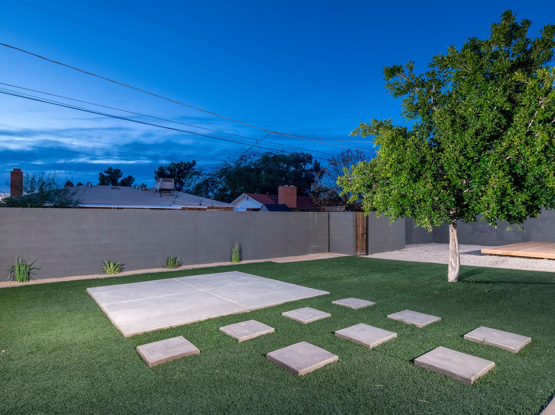 Pavers and artificial turf make for a low-maintenance backyard in this 1958 property.