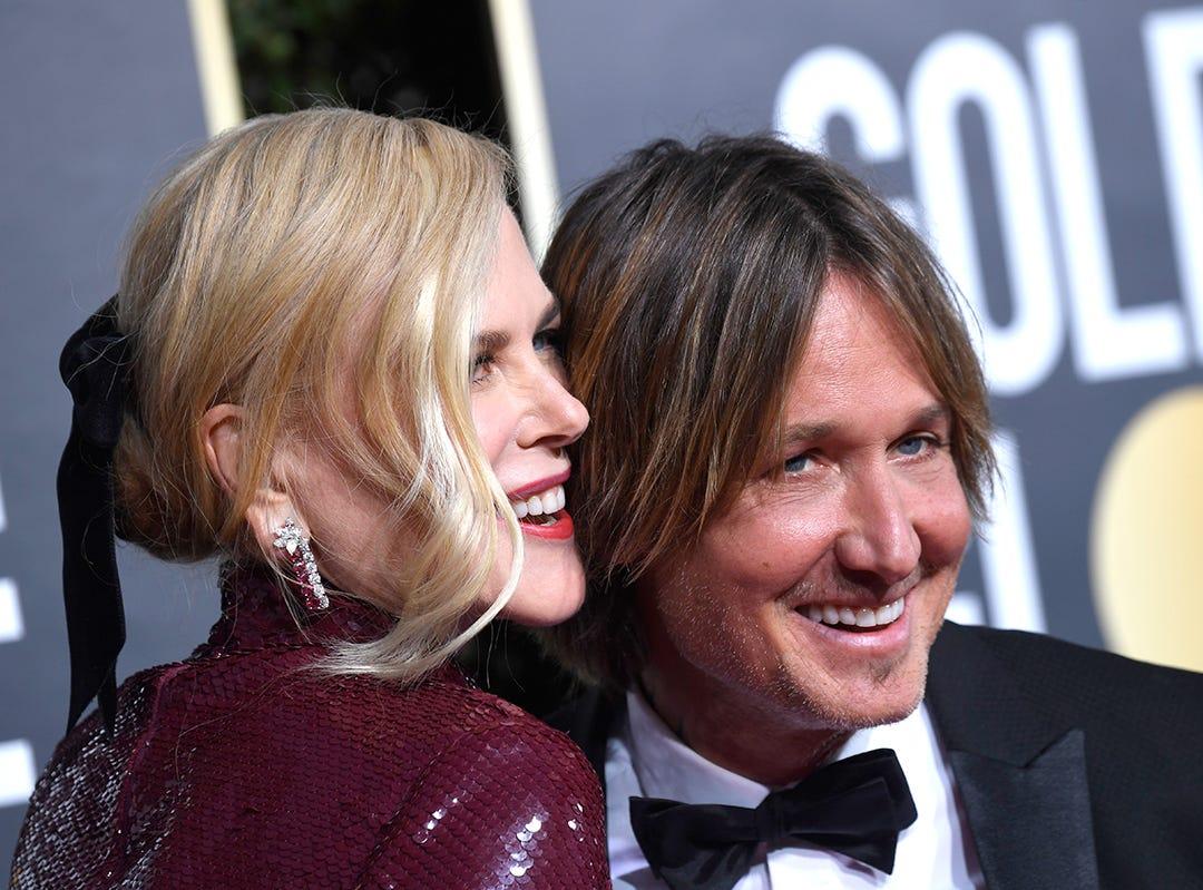 Nicole Kidman (izq) y Keith Urban asisten a la 76ª entrega anual de los Globos de Oro en el Beverly Hilton Hotel el 6 de enero de 2019 en Beverly Hills, California.